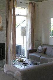 Wohn-Esszimmer mit Kamin und Dünenblick 11