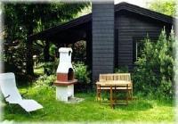 Gemütliches Holzhaus mit offenem Kamin, überdachter Veranda und Grillkamin im Garten, Baden 150 m