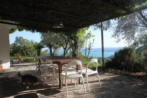 pergola with dining table andlake view