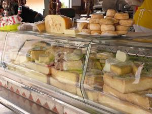 Market in Falmenta with cheese specialties