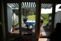Greetsiel-Ferienhaus für 2-4  Personen, Reiterhof, sonnige Südterrasse, Panoramablick, Bank am Siel