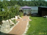 Ferienwohnung für 2 Personen am Malchower See - Wassergrundstück mit eigenem Bootssteg.