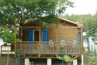 Gemütliches Ferienhaus aus Holz / große Terrasse & Poolanlage / Perfekt für kids! Wavetours vor Ort!