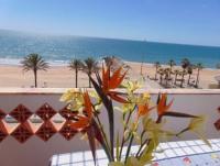 Algarve Ferienwohnung Nascer do Sol  mit Meerblick in der Strandpromenade von Quarteira, Portugal.