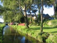 FH BATZ der Wassermühle von Kerellec hat  direkten Ausgang in den Garten und einen tollen Ausblick.