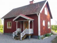 Ferienhaus Helsingen mit großer überdachten Terrasse in Hällefors, Västmanland.