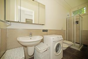2. Bathroom has washing machine and shower