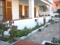 Die bequeme Ferienwohnung mit großer Veranda und 3 Schlafzimmern bietet Platz für 7 Personen