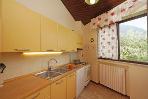Kitchen with coffee machine and microwave