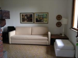 Casa 1-Mughetto: living-room with sofa and TV Sat.