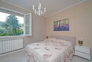 1. bedroom with double bed, window and wardrobe