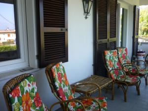 Big balcony with chairs and a small table