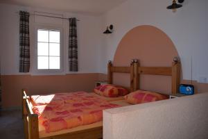 Emporen- Schlafzimmer der Wohnung 3