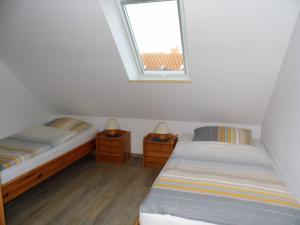 Ferienwohnung West -Schlafzimmer